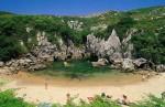 Пляж-ракушка Плайя-де-Гульпиюри, Испания
